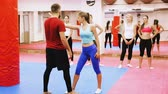 uppercut : Young woman is doing self-defense.