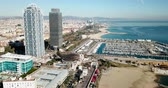 port of barcelona : Aerial view of Barcelona cityscape with skyscrapers on the Mediterranean coast Stock Footage