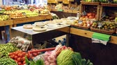 raflar : Variety of fresh vegetables and fruits in shopping cart in greengrocery