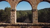 arkeolojik : View of Pont del Diable with two levels of arches, antique Roman aqueduct near Spanish town of Tarragona Stok Video