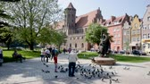 sídelní struktura : GDANSK, POLAND - MAY 12, 2018: Park Swietopelka and St. Petersburg. Nicholas Roman Catholic Church in city Gdansk Dostupné videozáznamy