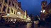 peculiar : TORUN, POLAND - MAY 11, 2018: View of the illuminated streets of the Polish town of Torun in the evening Stock Footage