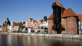 пришвартованный : GDANSK, POLAND - MAY 12, 2018: View of the Motlawa embankment in the Polish city of Gdansk in sunny day
