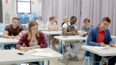 course pied : Multinational group of adult students listening teacher in classroom Stock Footage