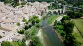 načervenalý : Aerial view of the historic center of Besalu with Romanesque bridge over Fluvia river, Catalonia, Spain Dostupné videozáznamy