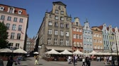 cafe na : GDANSK, POLAND - MAY 12, 2018: Picturesque architecture of popular tourist street Long Market in Gdansk Stock Footage