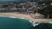 travel cage : View from the drone of the Spanish island of Lloret de Mar on the Mediterranean coast in the summer day Stock Footage