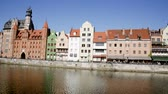 peculiar : GDANSK, POLAND - MAY 12, 2018: View of the Motlawa embankment in the Polish city of Gdansk in sunny day