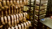 dana eti : Sausages hanging on racks prepared for smoking at meat and sausage making plant