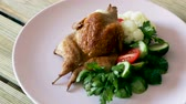 studentka : Tasty fried quail tobacco served with boiled and fresh vegetables and greens