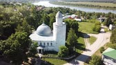 Aerial view of city landscape of Kasimov on Oka river with oldest Khan mosque, Russia