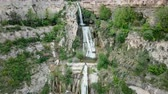 View from drone on waterfall on Sant Miquel del Fai in the Spain.