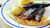 bolinho : Image of deliciously fried sprats with potato croquettes on plate