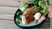couve : Vegetables sprouts and broccoli served with fried meat and tomatoes