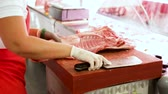sorts : Close-up of butchers cutting quality porks in butchers shop