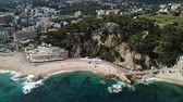 View from the drone of the Spanish island of Lloret de Mar on the Mediterranean coast in the summer day Stock Footage