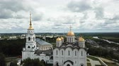 View of Dormition Cathedral on a background with Vladimir cityscape in sunny summer day, Russia Stock Footage