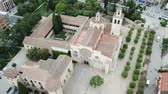 Aerial view of monumental Benedictine Monastery in Spanish town of Sant Cugat