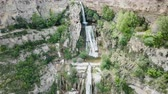 catalão : View from drone on waterfall on Sant Miquel del Fai in the Spain.