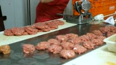 butchers : Process cooking for sale in butchers shop Stock Footage