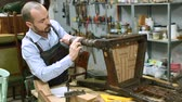 antyki : Concentrated craftsman using carpentry tools for restoration old armchair in workshop Wideo