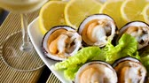 деликатес : Raw bivalve shellfishes (European bittersweet) served with lemon on plate