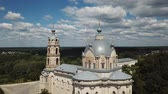 classicism : Belfry and dome of Church of Life-Giving Trinity in Gus-Zhelezny on background with greenery and cloudy summer sky, Russia Stock Footage