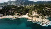 ドメイン : View from the drone of the Castell den Playa in the Mediterranean coastal town of Lloret de Mar, Catalonia, Spain