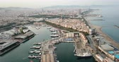 parked : Aerial view from drones of old port in Barcelona with sailboats and yachts