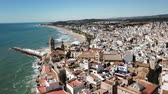 taşra : Panorama of the coastal city of Sitges with the building of the church, Barcelona, ??Spain Stok Video