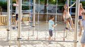 зависать : Glad smiling children playing at the playground together