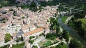 reddish : Aerial view of the historic center of Besalu with Romanesque bridge over Fluvia river, Catalonia, Spain Stock Footage