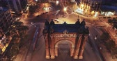 triumphal arch : Triumphal Arch (Arco de Triunfo) on central avenue at twilight, Spain