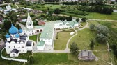 Aerial panoramic view of the Cathedral of the Nativity of the Virgin in Suzdal Kremlin on a cloudy summer day, Russia Stock Footage