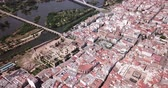 Aerial panoramic view of the city of Guadiana River with ancient pedestrian Roman Bridge, Spain