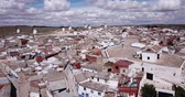 Top view of the windmills and houses of the city of Campo de criptana. Spain
