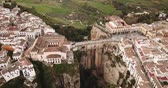 Aerial view of the rocky landscape of Ronda with buildings and Bridge, Andalusia, Spain Vídeos
