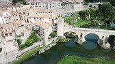 pannendak : View from drone of medieval Spain town of Besalu with Romanesque bridge over Fluvia river