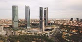 semt : MADRID, SPAIN - JUNE 16, 2019: High view of four modern business skyscrapers (Cuatro Torres) in Madrid, Spain Stok Video