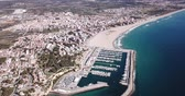 швартовка : Picturesque aerial view of Mediterranean coastal town of Torredembarra with yachts moored in harbor, Tarragona, Spain