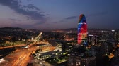 технологический : Night aerial view of modern Barcelona cityscape with colorful Torre Glories