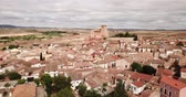 csempézett : View from drone of Cervera de la Canada cityscape overlooking fortified Catholic church of Iglesia de Santa Tecla, Spain