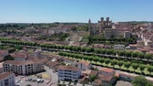 csempézett : Aerial view of Roman Catholic Auch Cathedral on background of summer cityscape, France