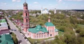 taşra : Scenic architectural ensemble of ancient Savior Transfiguration Cathedral and Trinity Church with extended bell tower on Bolkhov cityscape background, Russia Stok Video