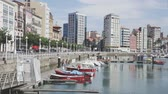 швартовка : GIJON, SPAIN - JULY 15, 2019: Scenic view of city embankment near sports port with moored yachts