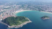 швартовка : Scenic view from drone of Spanish town of San Sebastian (Donostia) on southern coast of Bay of Biscay on sunny summer day, Basque Country