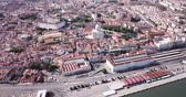 buurt : Picturesque aerial view of historical district of Lisbon on bank of Tagus river with medieval Monastery and white baroque building of Church of Santa Engracia, Portugal Stockvideo