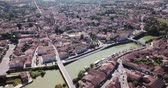 condoom : Aerial view of Condom cityscape on banks of Baise river overlooking Catholic cathedral, France