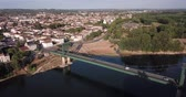 watercourse : View from drone of summer Marmande cityscape with Notre-Dame de Marmande, France Stock Footage