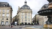 classicism : BORDEAUX, FRANCE - JULY 18, 2019:  View of impressive classical French architecture on Place de la Bourse (former Royal square) in Bordeaux, France